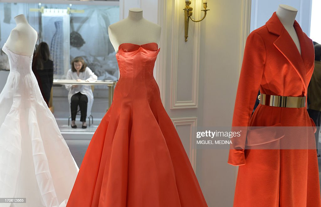 View of dresses displayed at the headquarters of French luxury brand Dior in Paris on June 15, 2013.