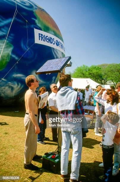 View of Earth Day rally attendees as they stand near a large inflatable globe near the US Capitol Grounds Washington DC April 22 1990