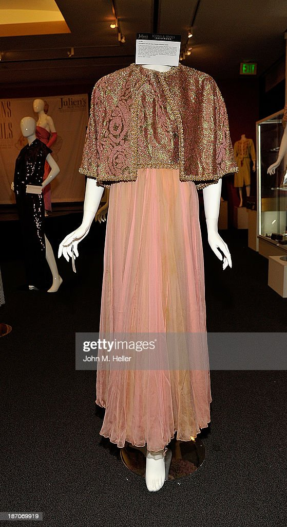 A view of Elizabeth Taylor's Teal Trania dress at the press preview for Icons & Idols Fashion and Hollywood Exhibit at Julien's Auctions Gallery on November 5, 2013 in Los Angeles, California.