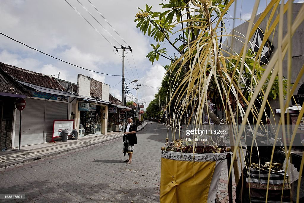 A view of empty Legian street during the observation of 'Silence Day' on March 12, 2013 in Denpasar, Bali, Indonesia. Nyepi means 'Day of Silence' and is observed every new year according to the Balinese calendar. The Hindu celebration is one of self-reflection and meditation and activities such as working, watching television or travelling are restricted between the hours of 6am and 6pm. Streets are deserted during these hours occupied only by the 'Pecalang', the security team in place to monitor that the restrictions are being followed.