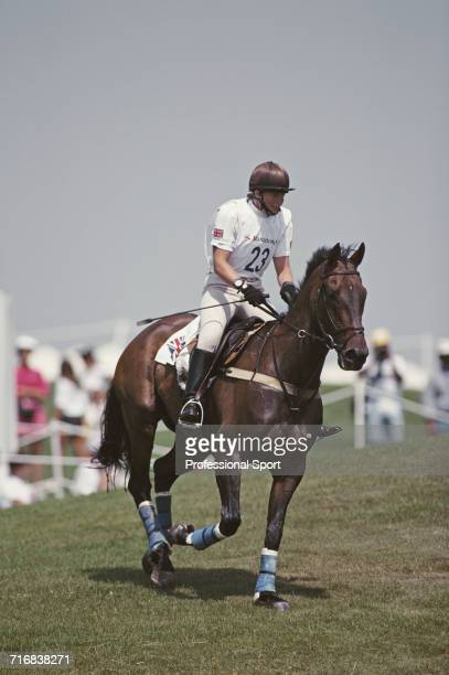View of English equestrian Karen Dixon of the Great Britain team in action riding Get Smart during competition in the cross country section of the...