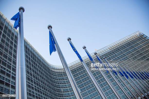 A view of European flags in front of the European Commission headquarters at the Berlaymont Building in Brussels during the federal regional and...