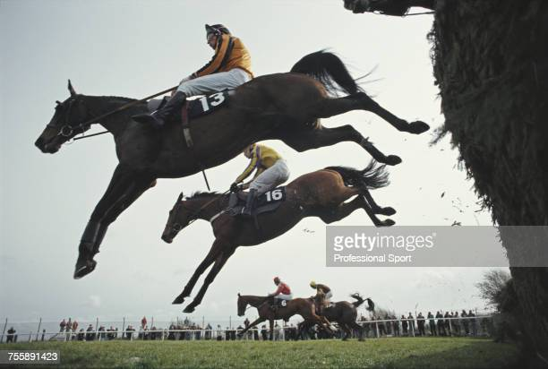 View of eventual winner Sirrah Jay ridden by Adrian Maguire and Strong Gold pictured clearing Becher's Brook fence during the 1993 Topham Chase horse...