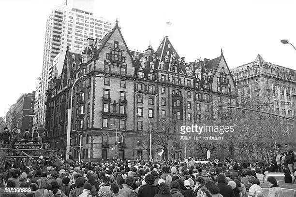 View of fans gathered outside the Dakota Apartments during a memorial vigil for murdered musician John Lennon New York New York December 14 1980...