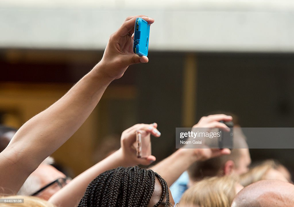 A view of fans holding smart phones during Singer Rachel Platten's performance on NBC's 'Today' at Rockefeller Plaza on July 1, 2016 in New York City.