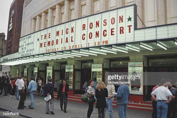 View of fans standing outside the Hammersmith Odeon prior to attending the Mick Ronson Memorial Concert at the venue in London on the 1st anniversary...