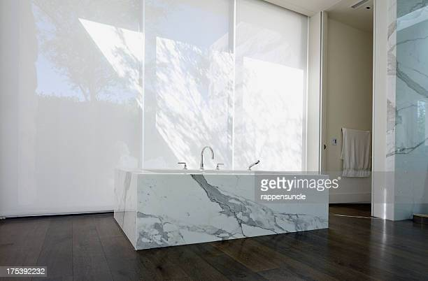 View of faucet and a marble sink in a modern bathroom
