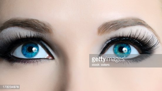 View of female blue eyes with long lashes