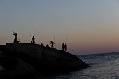 View of fishermen on Arpoador beach at sunset in Rio de Janeiro Brazil July 10 2010 Photo by Lisa Wiltse