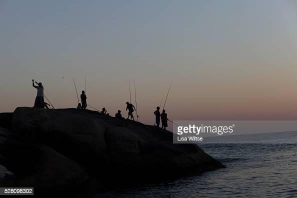 View of fishermen on Arpoador beach at sunset in Rio de Janeiro Brazil July 10 2010 Photo by Lisa Wiltse