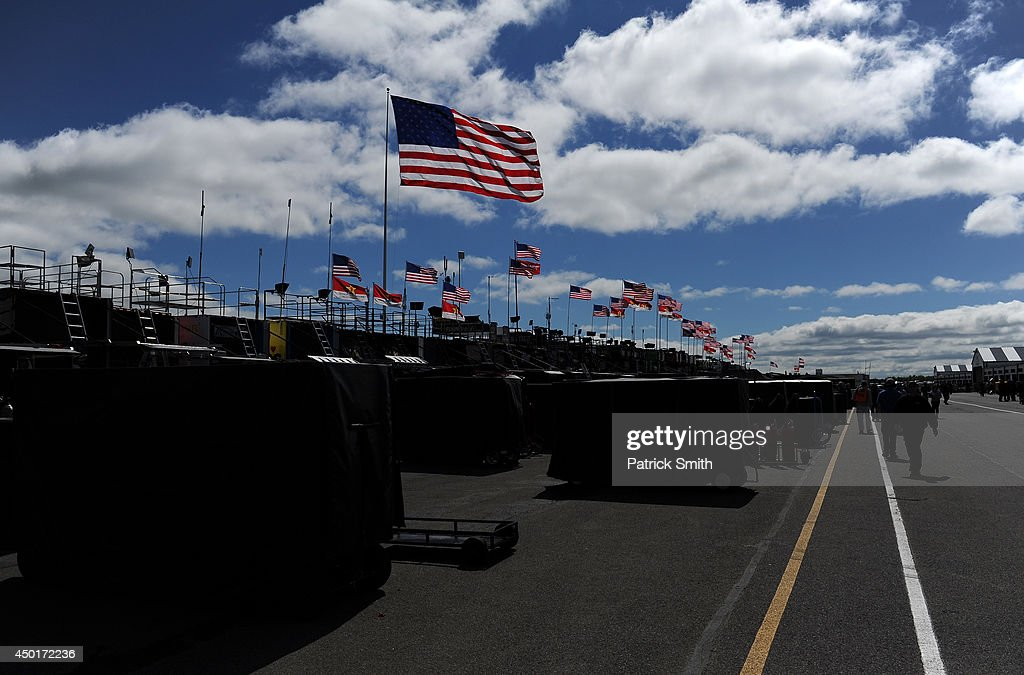 A view of flags on top of the haulers in the garage area during practice for the NASCAR Sprint Cup Series Pocono 400 at Pocono Raceway on June 6, 2014 in Long Pond, Pennsylvania.