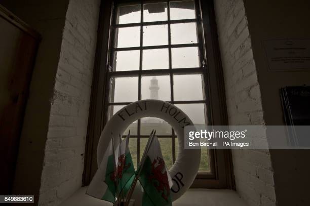 A view of Flat Holm lighthouse from within the gfit shop which is housed in the old Victorian stone barracks built in 1869 to sleep up to 50 men on...