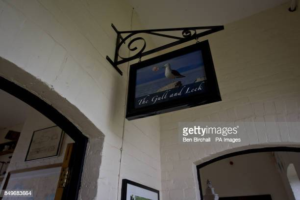 A view of Flat Holm pub sign which is housed in the old Victorian stone barracks built in 1869 to sleep up to 50 men on Flat Holm island in the...