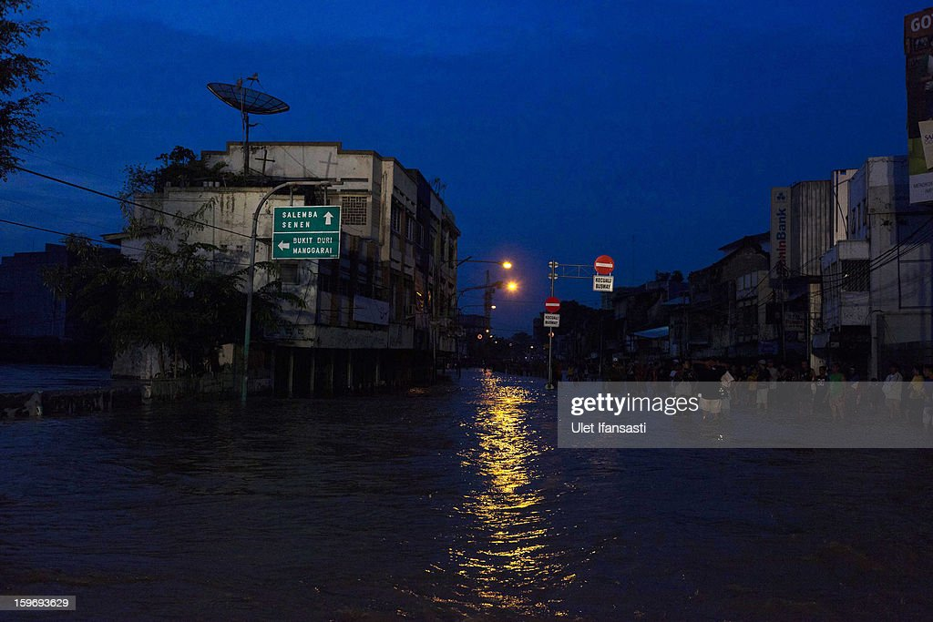 A view of floodwaters as the Ciliwung River overflows in East Jakarta district on January 18, 2013 in Jakarta, Indonesia. According to the National Disaster Management Agency, about 50 percent of the capital is under water following the floods which have so far claimed eleven lives and displaced thousands of Indonesians.