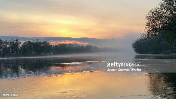 View Of Foggy Sunrise Over River