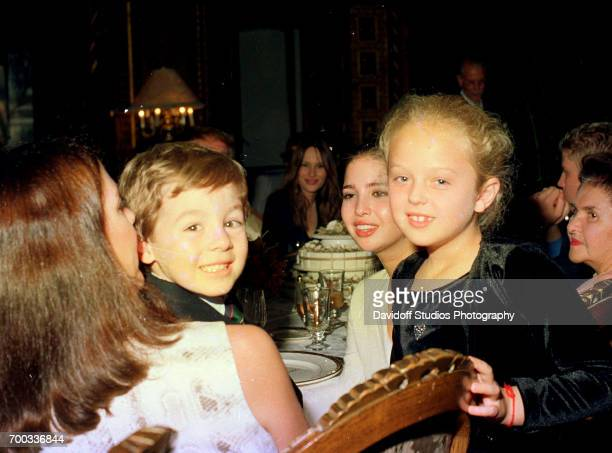 View of fore from left Lisa Aitkin Desmond and her son Robert Desmond Ivanka Trump and her halfsister Tiffany Trump as they sit together during a...