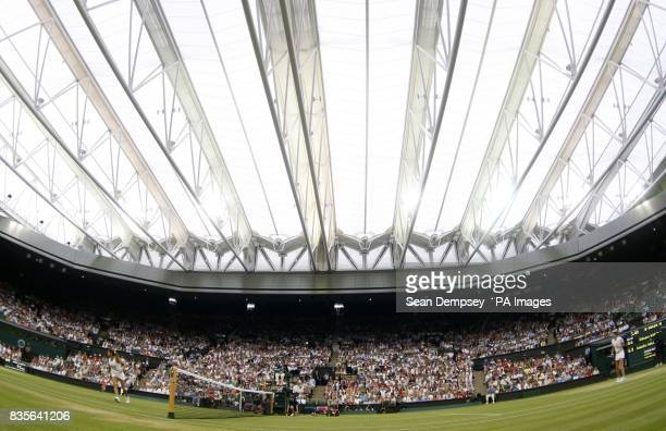 A view of France's Amelie Mauresmo in action against Russia's Dinara Safina on Centre Court with the roof closed during the Wimbledon Championships...