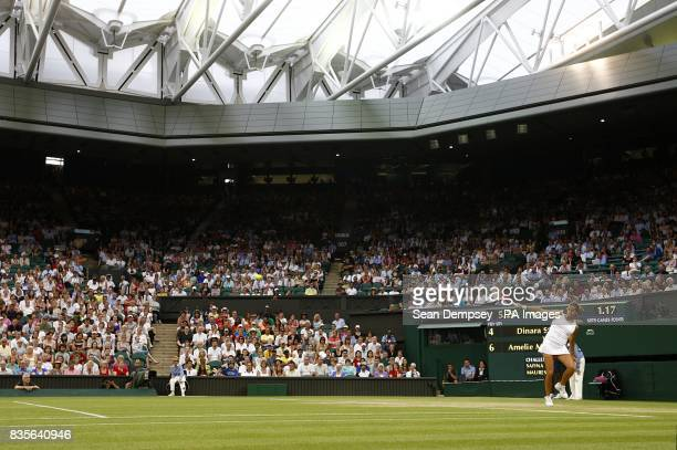 A view of France's Amelie Mauresmo in action on Centre Court with the roof closed during the Wimbledon Championships at the All England Lawn Tennis...