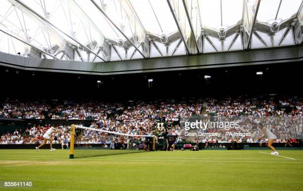 A view of France's Amelie Mauresmo playing Russia's Dinara Safina with the roof closed on Centre Court during the Wimbledon Championships at the All...