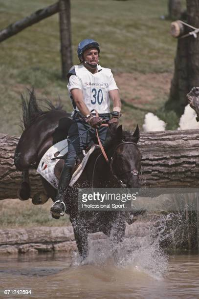 View of Francesco Girardi of the Italian equestrian team riding Stormy Weather during competition for Italy to finish in 56th place in the Mixed...