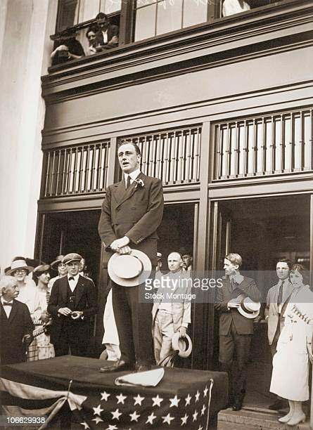View of Franklin Delano Roosevelt announcing himself as a candidate for vicepresident of the United States 1920 He holds his hat and is standing on a...