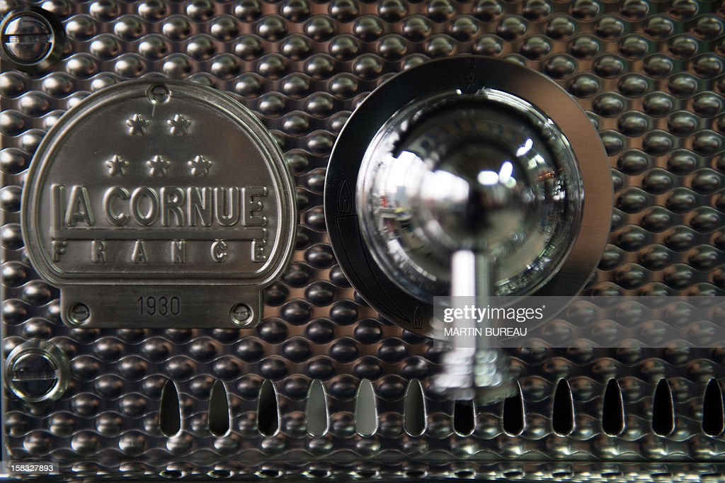 A view of French cooker maker 'La Cornue's' logo is pictured in the factory on December 13, 2012, in Saint-Ouen-l'Aumone, north of Paris. AFP PHOTO / MARTIN BUREAU