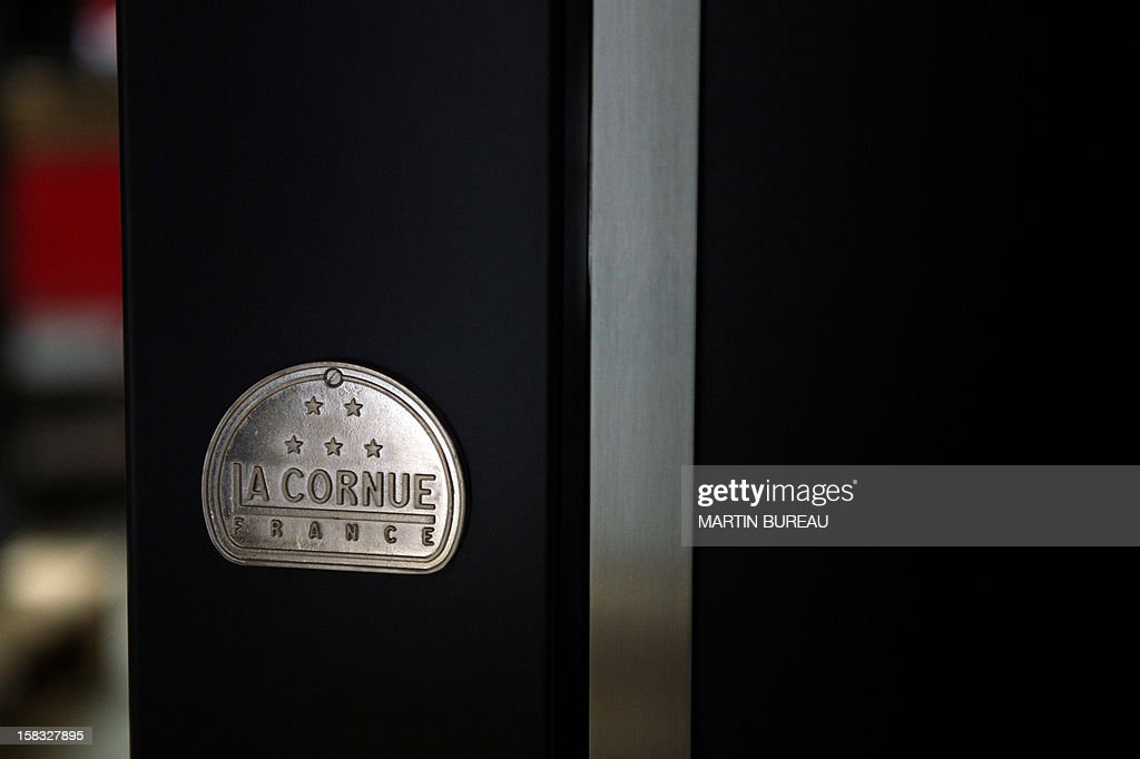 A view of French cooker maker 'La Cornue's' logo is pictured in the factory on December 13, 2012, in Saint-Ouen-l'Aumone, north of Paris.