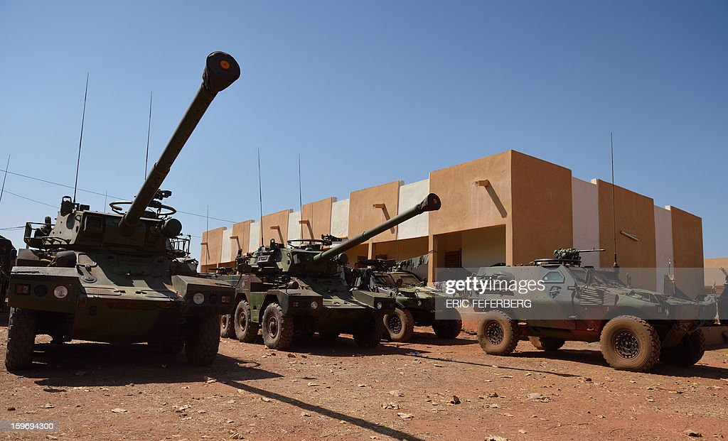 A view of French Panhard ERC 90 Sagaie, six-wheeled armoured all terrain reconnaissance vehicles, and an armoured vehicule, at the Malian army 101 airbase, where French troops are stationed, on January 18, 2013, near Bamako. France now has 1,800 troops on the ground in Mali, inching closer to the goal of 2,500 it plans to deploy in its African former colony, Defence Minister Jean-Yves Le Drian said today. That was 400 more than a day earlier, said the minister as he met with French special forces in the western port of Lorient. The troops have been sent to help the Malian army regain control of the north from Islamist groups.