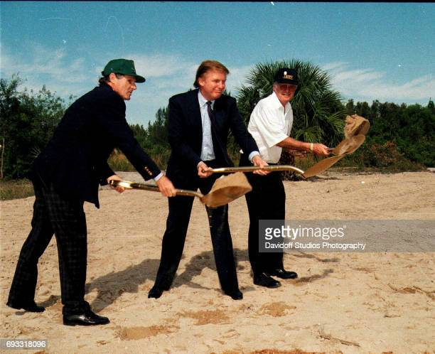 View of from left businessman Alfons Schmitt real estate developer Donald Trump and golf course architect Jim Fazio each with a 'golden' shovel at...