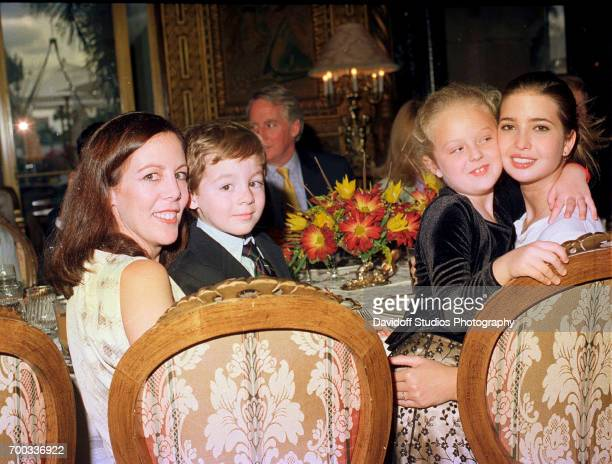 View of from left Lisa Aitkin Desmond and her son Robert Desmond Tiffany Trump and her halfsister Ivanka Trump as they sit together during a...