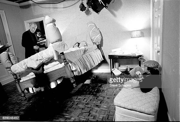 View of from left Swedishborn French actor Max von Sydow unidentified American actress Linda Blair and film director William Friedkin as they prepare...