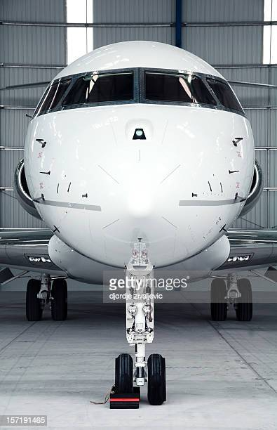 View of front nose of a small private passenger jet airplane