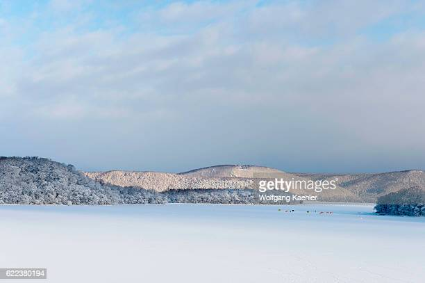 View of frozen Lake Abashiriko and forest covered with snow near Abashiri a city on Hokkaido Island Japan with colorful tents setup on the ice for...