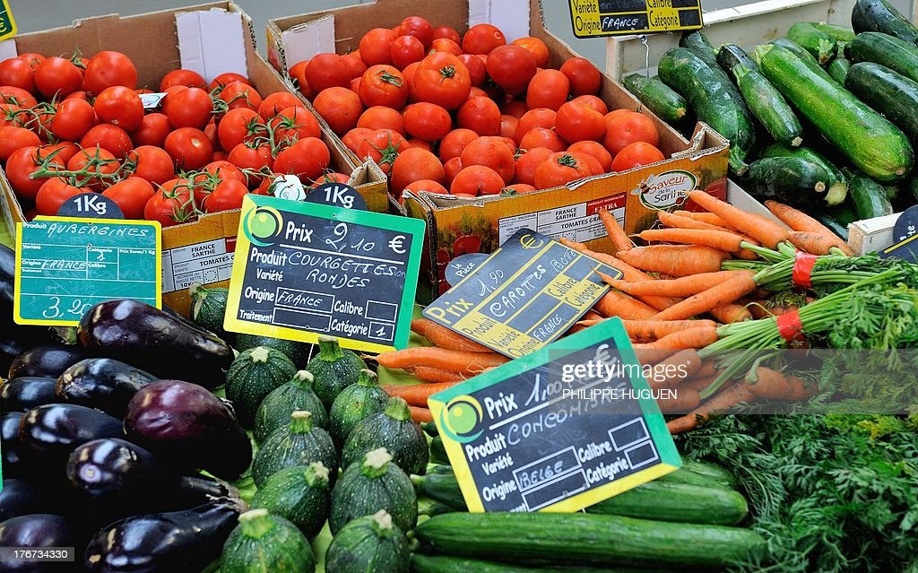 A view of fruit and vegetable stalls at a market in Lille, on August 18, 2013. While several organizations are denouncing the rise in the price of fruits and vegetables this summer by over 14% to 17%, a major farmers union from the Lot-et-Garonne region is preparing to sell fruits and vegetables directly to consumers in Paris and surrounding cities at a 'fair price' to protest against the excessive profit margins of large scale retail and stores which they say make it impossible for them to earn a fair amount for their produce.