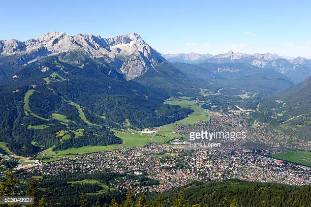 View of Garmisch-Partenkirchen, Zugspitze mountain, Jubilaeumsgrat ridge and Alpspitze mountain as seen from Wank mountain, Upper Bavaria, Bavaria, Germany, Europe