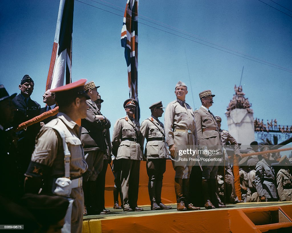 View of General Dwight D Eisenhower (1890-1969) and other Allied commanders standing on the saluting platform during the Victory Day parade in Tunis,Tunisia on 20th May 1943. Standing next to Eisenhower is French General Henri Giraud and behind are General Alphonse Juin, General Georges Catroux, General Harold Alexander, General Kenneth Arthur Noel Anderson and RAF Marshal Arthur Tedder.