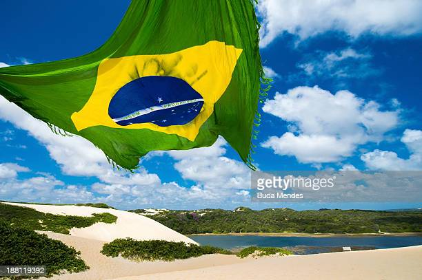 View of Genipabu lagoon with a Brazilian flag on November 14 2013 in Natal Brazil The Ecological Tourist Park Dunes Genipabu includes a beach a large...