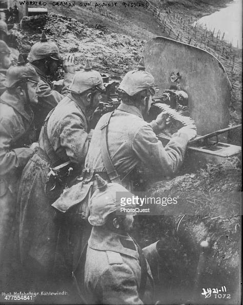 View of German soldiers as they man a machine gun during World War I mid to late 1914