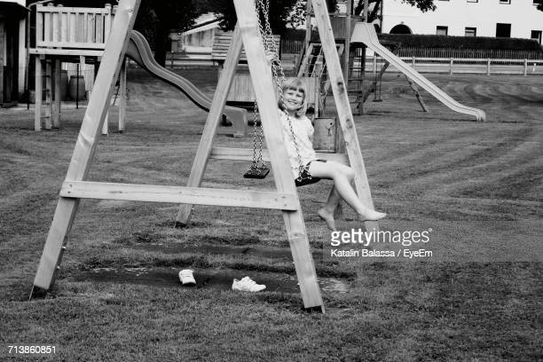 View Of Girl On Swing