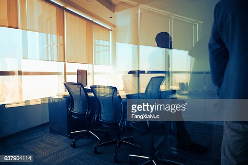View of glass reflection in business office during meeting