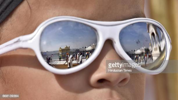 A view of Golden Temple displayed on the sunglass of a devotee on the occasion of Baisakhi festival on April 13 2017 in Amritsar India Baisakhi is a...