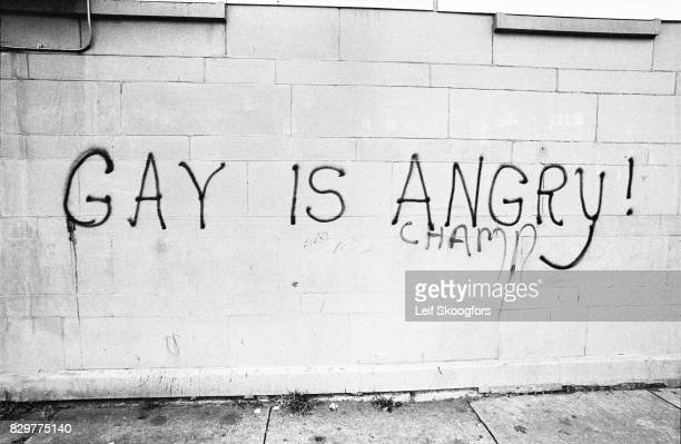 View of graffiti that reads 'Gay is Angry' on a brick wall New York New York late summer 1969