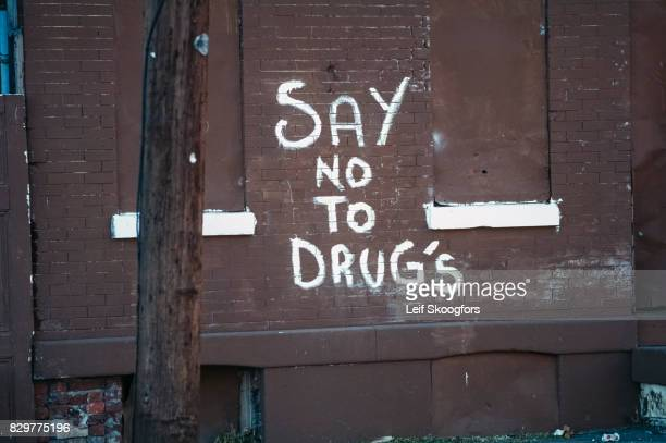 View of graffiti that reads 'Say No to Drugs' on brick wall Philadelphia Pennsylvania 1992 Due to a prevalence of drugrelated crime the area was...