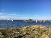A pier on Great South Bay seen from the shore of Fire Island, New York