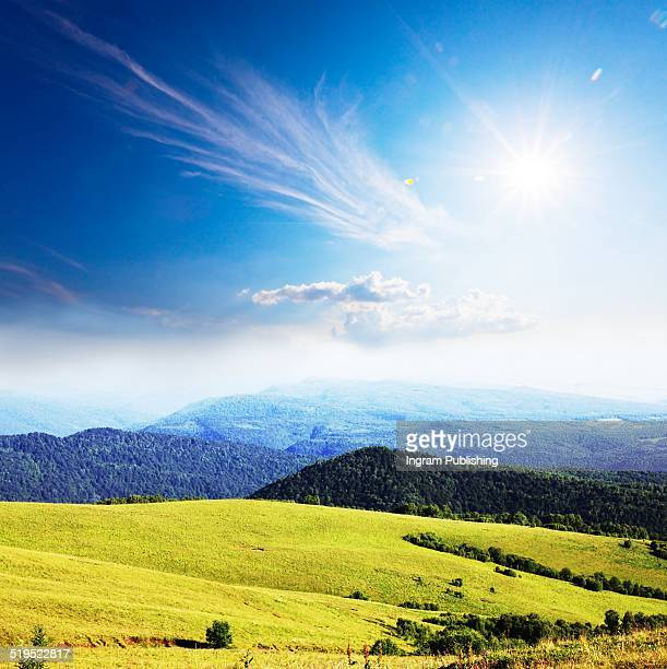 View of green hills in summer