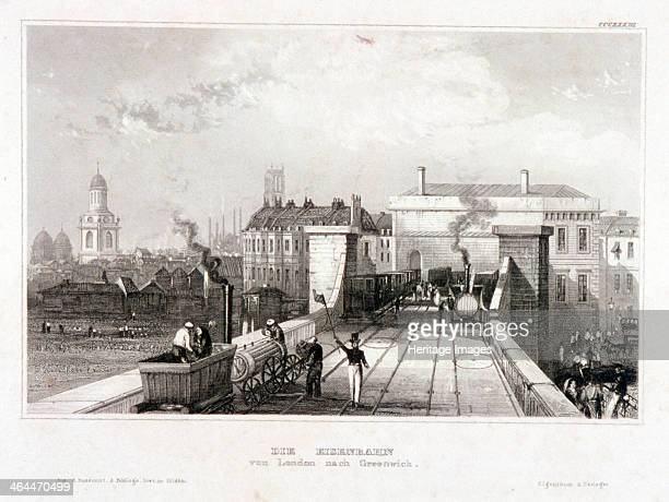 View of Greenwich Railway Station London c1840 with steam trains and a signalman
