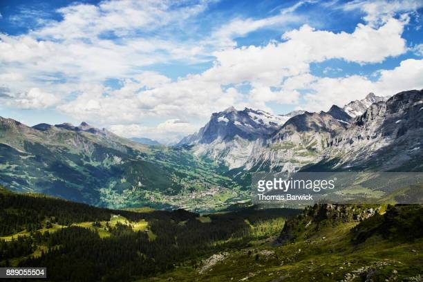 View of Grindelwald Switzerland and surrounding peaks on summer afternoon