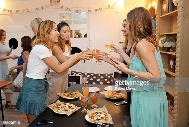 A view of guests enjoying their pizzas and cocktails during host Katherine Schwarzenegger's Amazon Echo cooking class at AU FUDGE on August 4 2016 in...