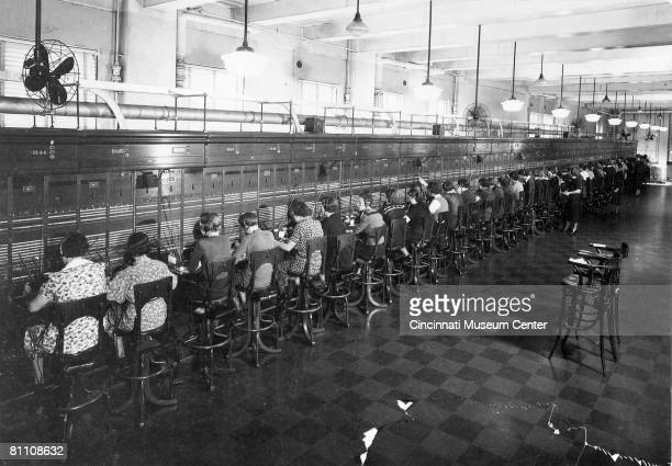 View of half of the operators at work on world's longest straight switchboard at the City and Suburban Telegraph Company Cincinnati Ohio 1930s