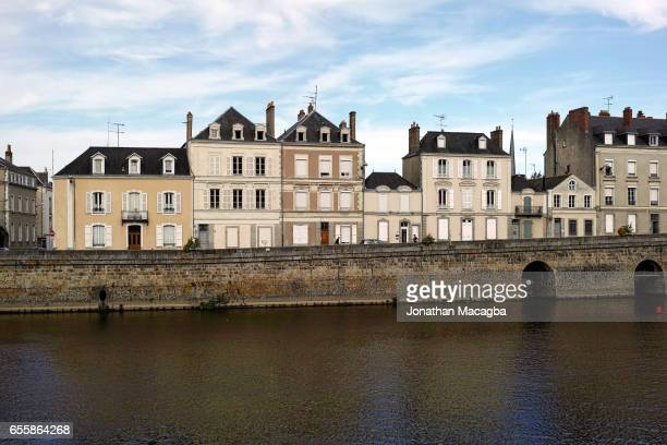 View of historic buildings across the Mayenne River in Laval, France